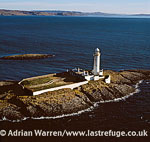 The Eilean Musdile lighthouse at the southern tip of the Isle of Lismore, Sound of Mull, Scotland